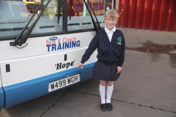 Amy names training bus
